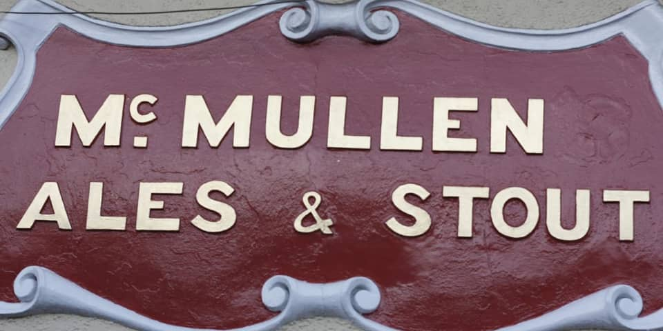 Photograph of architectural lettering: McMullen ales and stout