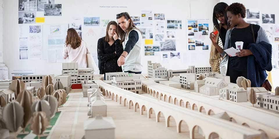 Visitors looking at an architects model