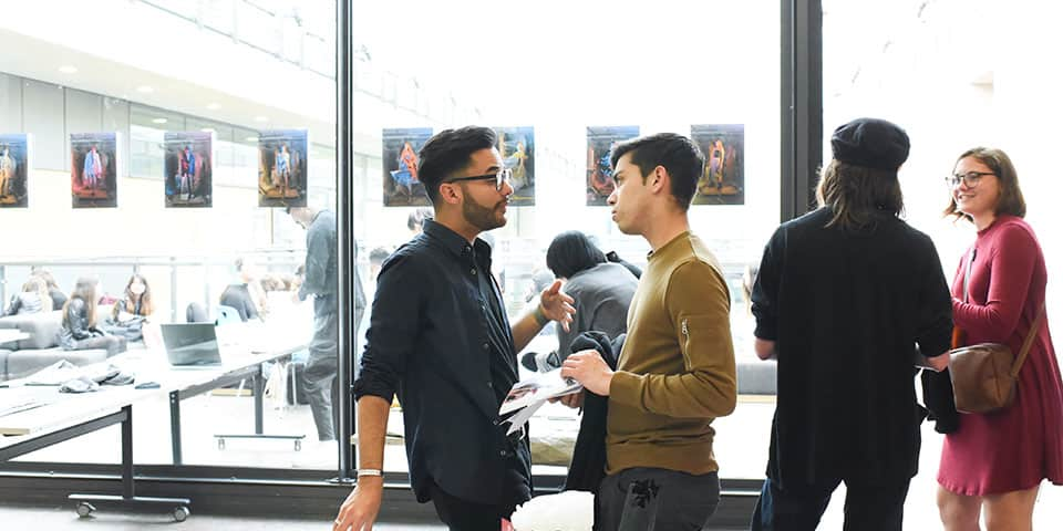 Student and teacher in conversation