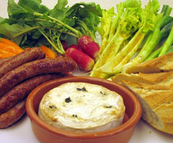 Baked goats cheese with Merguez sausages | Good Food Channel