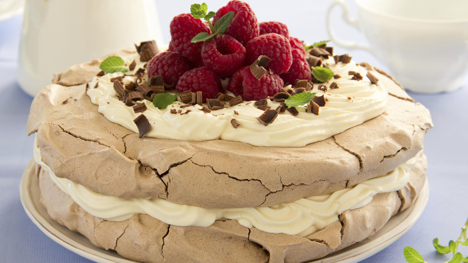 hazelnut meringue torte filled with raspberries and cream