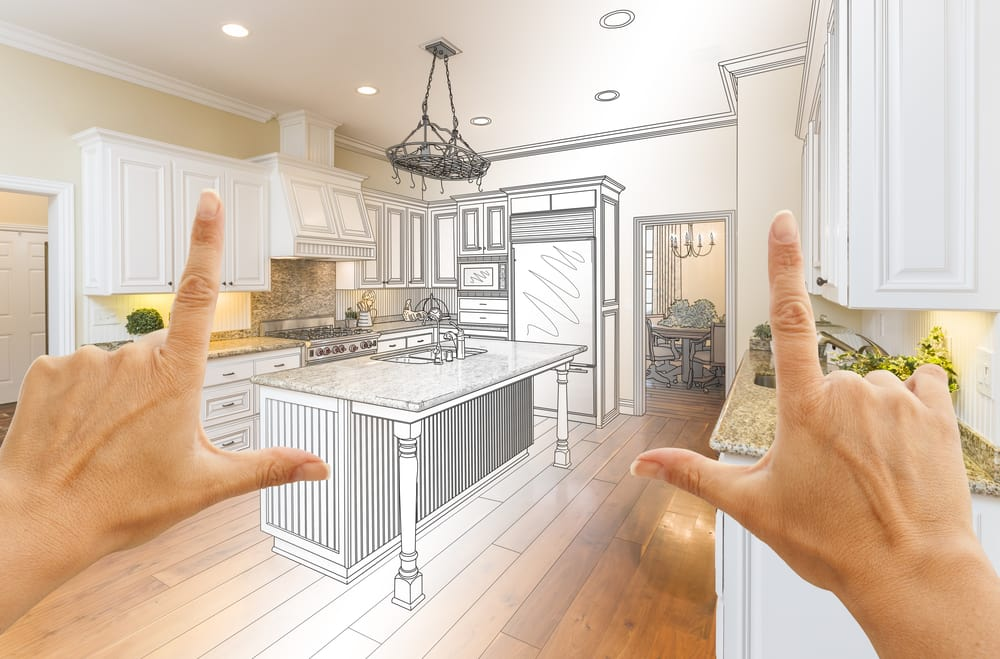 Home Renovation planning with fingers looking at a design kitchen