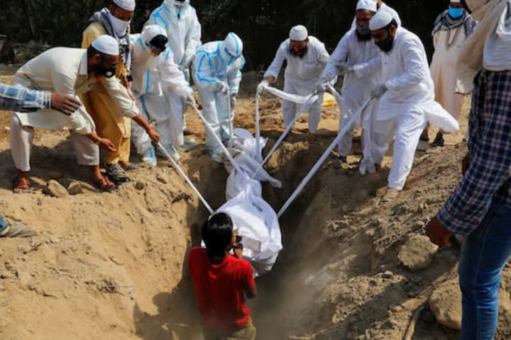 India sets new COVID-19 records in daily cases, deaths