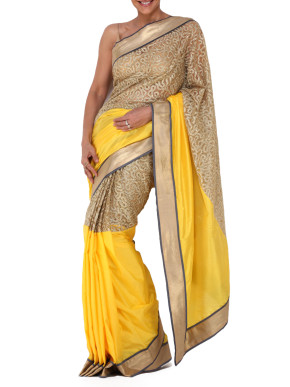 Precision cut grey panelled yellow and gold saree