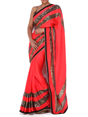 Orange saree with sequinned stripes