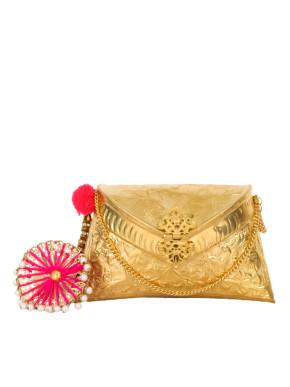 Gold  clutch with pink umbrella tassel