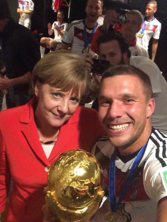 Angela Merkel und Lukas Podolski