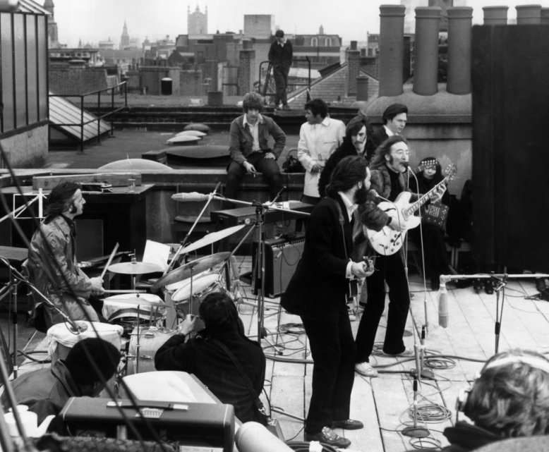 The Beatles on a rooftop in Savile Row