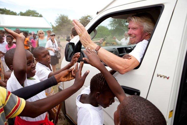 Hi-fiving children in South Africa