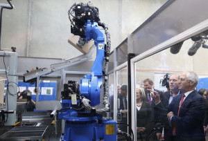 PM praises bottled vitamin automation in pre-election factory tour