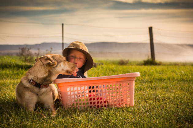 A boy a big hat and his faithful companion © Kelly Ryan