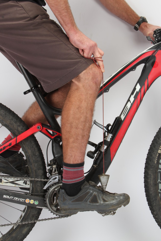A forward saddle position will assist when climbing but don't take it too far. Drop a line down from the front of your knee and the plumb bob should fall behind the ball of your foot.