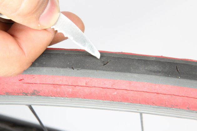 Inspect your tyres closely. If you find any cuts, use a pointed implement to inspect for glass or metal. Don't get too carried away, just have a gentle dig and feel for anything sharp that could cause repeat punctures. If you have to fix a flat on the ride, always feel around inside the tyre casing and inspect any cuts before refitting the inner tube.