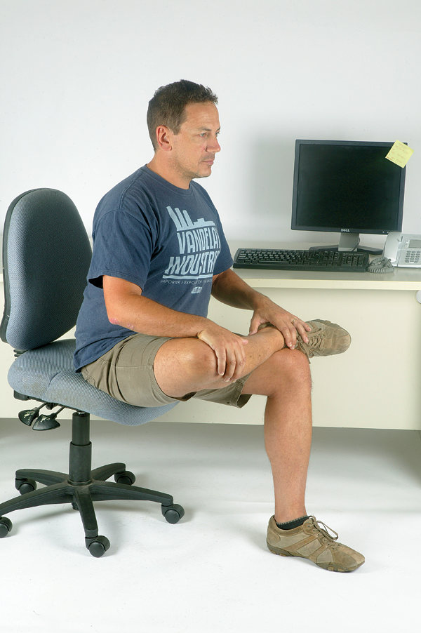 Sitting all day will also cause your gluteals to shorten, resulting in an upright pelvis when in the saddle. The hip internal rotator stretch will make your handlebars seem much closer than they would otherwise. Sitting on edge of chair, place your right ankle on left knee. Now push your right knee forwards and out to the right side with your hand. Lean forwards at the hips and you should feel the stretch in the back of your right buttock.