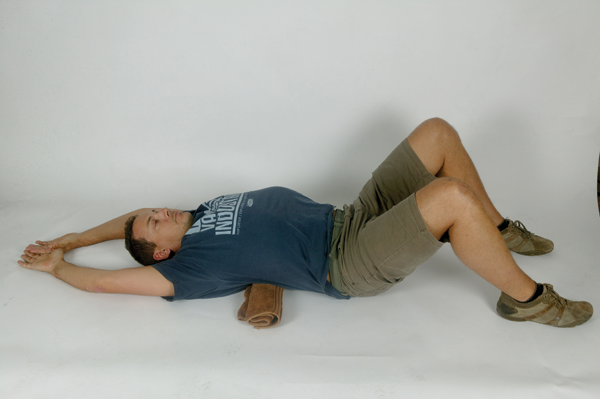 Okay, dropping to the ground underneath your desk may not be viable at the office, but this is a nice passive stretch that shouldn't be too much of an imposition before bed. It is hard to get your head on top of your shoulders, and keep your shoulders back, unless you have good mid-back mobility. This stretch should be a pleasure after a long day tapping the keys (and also after a long day in the saddle for those lucky enough to get out!) Lay on your back, hips and knees bent, feet on the floor. Have rolled up towel placed crossways underneath your back, in the mid-back (thoracic) area. Lift your arms above your head to rest on the floor. Hold 20 seconds, then repeat with towel in a slightly higher position. Do this one at the end of every day.
