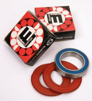 Enduro Bearings make replacement bearings for many applications with a choice of quality levels (you can even upgrade to ceramics if you choose). The Enduro kits replace the plastic dust shield with easy to fit rubber coated wiper seals (the red discs pictured here).