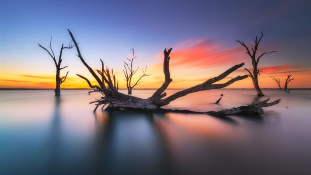 Lake Bonney on a clear dawn with slow moving cloud. Sony A7R2, Canon 16-35mm F4 lens. 100s @ f16, ISO 50. Sirui carbon fibre tripod and RRS BH55 ballhead. Nisi 6 stop ND filter and CPL. Additional 'radial blur', contrast and colour adjustments in Adobe Photoshop CC.