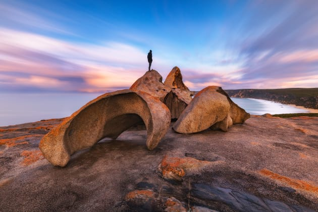 5. Clouds blow past the Remarkable Rocks at Kangaroo Island shortly after dawn. Sony A7R2 ,Canon 16-35mm F4 lens. 200s @ f16, ISO 100. Sirui carbon fibre tripod , RRS BH55 ballhead , Nisi 10 stop ND filter and CPL. Blending of separate exposure for human presence, colour and contrast adjustments in Adobe Photoshop CC.