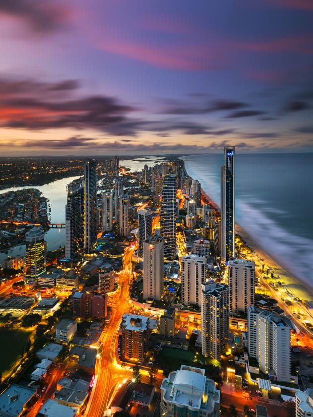 Sunset as seen from Q1 observation deck on the Gold Coast. Sony A7R2 , Canon 16-35mm F4 lens. 100s @ f11, ISO 100. 2 exposures 20 minutes apart. Sirui carbon fibre tripod , RRS BH55 ballhead Nisi 6 stop ND filter, Nisi 3 stop hard edged GND. Exposure blending, colour and contrast adjustments in Adobe Photoshop CC.