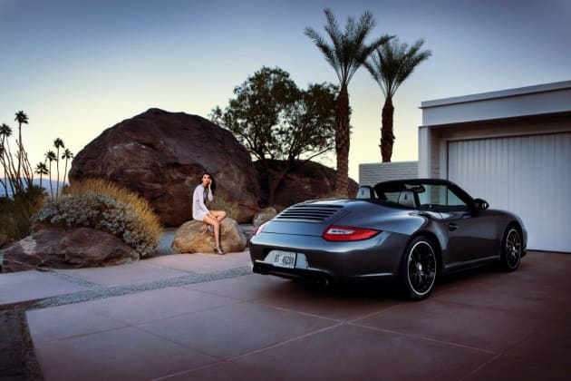 Porsche fashion spread, with grid-spot on talent from camera plus coloured graduated filter to darken sky. © Michael Grecco.