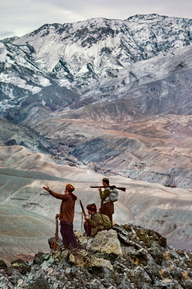 Logar province, 1984. Three mujahideen on a mountain in the Hindu Kush range.