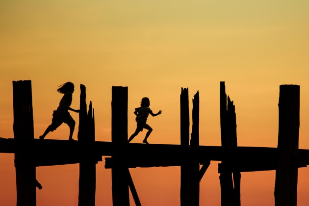 Two young children run across U Bein Bridge at sunset in Mandalay, Myanmar. This was the perfect opportunity to capture interesting silhouettes of people crossing the river on their way home from work/school. Timing the moment when the kids passed by the pillars was the challenging part. I didn't want them to be obscured by the pillars. By waiting for the right moment helped divide the image into sections for a cleaner composition. Canon 6D, 70-200 f/2.8 @ 200mm, 1/640s @ f4.5, 200 ISO, handheld from a boat on the river. Contrast, saturation and colour balance adjusted in Adobe Lightroom.