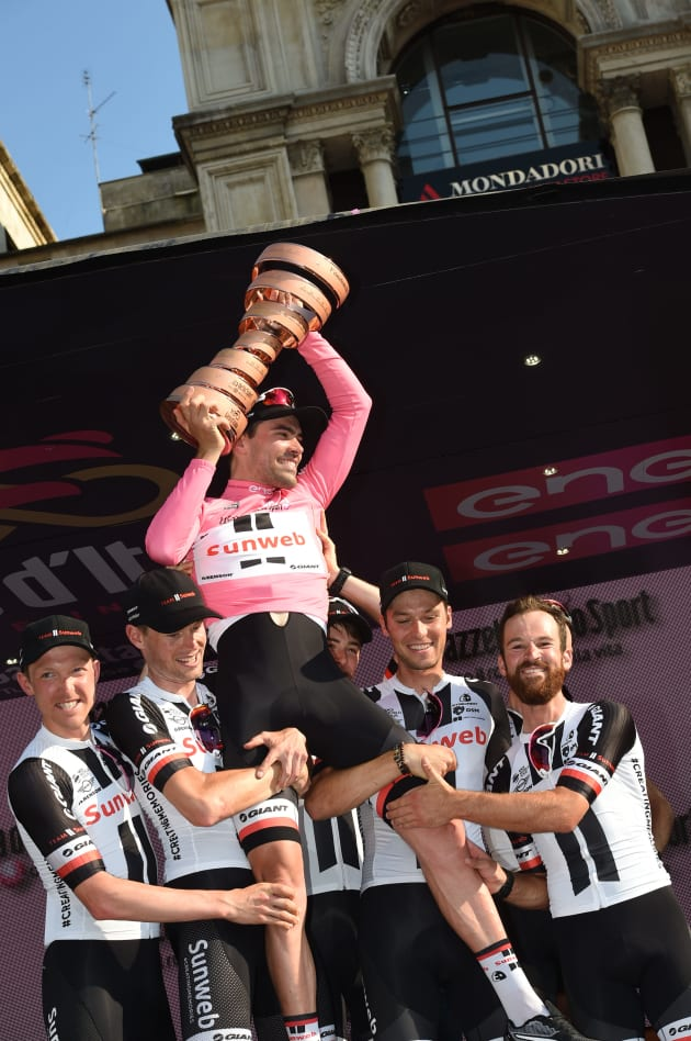 Tom Dumoulin is held aloft by his thrilled Sunweb teammates after winning the 100th Giro. Image: Sirotti.