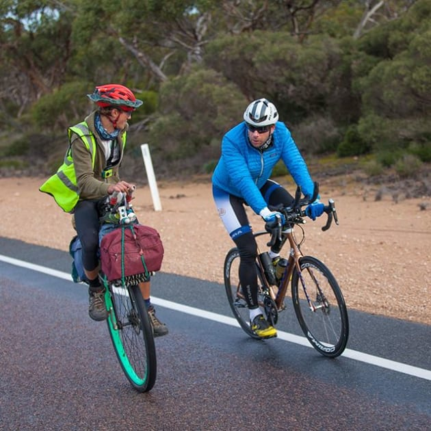 Mark Beaumont and Ed Pratt cycling in remote South Australia. Image: Instagram / @Johnnyswanepoel