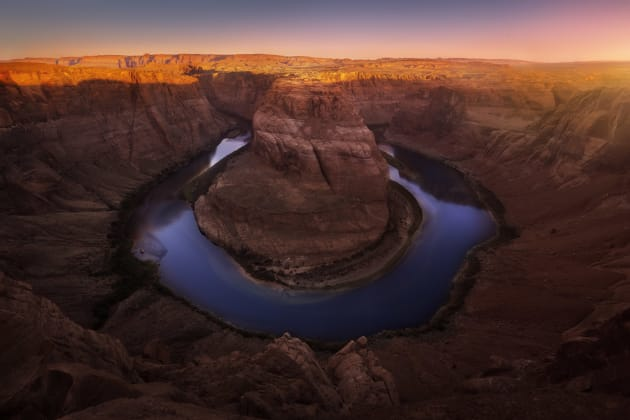 Horseshoe Bend in Arizona is an incredible site. I had photographed it sunset the night before but with swarms of people, I didn't get that peaceful felling I enjoy so much about shooting alone. So I returned at sunrise not quite expecting the light to do what it did! What a beautiful morning! Canon 5D mkII, Canon 16-35mm F2.8 II @ 16mm, 1/10s @ f13, ISO 50.