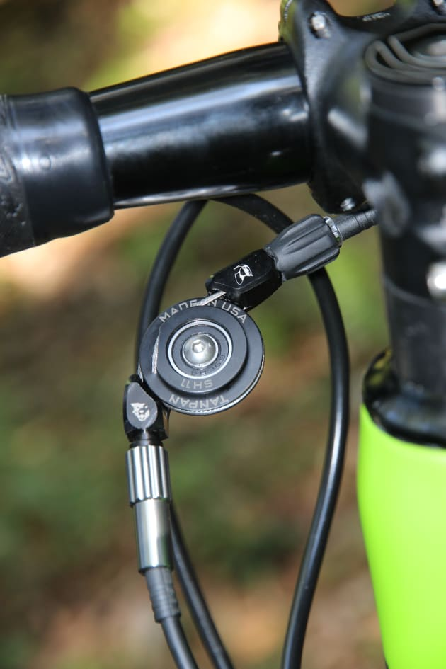 The Tanpan (by Wolf Tooth) allows you to run a MTB derailleur with Shimano's STI road gear levers.