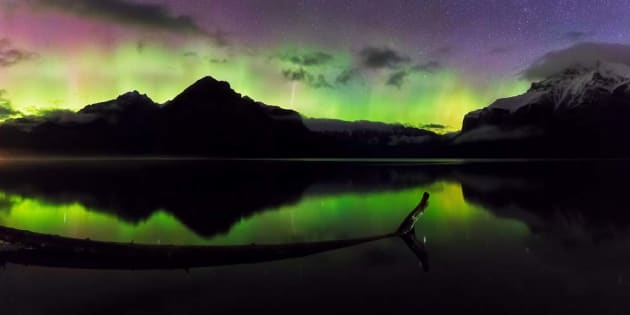Aurora borealis flickers above Lake Minnewanka near Banff. Canon EOS 5D MKIV, 16-35mm f4 lens, 10s @ f/4, ISO 6400, tripod with Sunway panning clamp. Nine horizontal images stitched. Panorama stitching, colour and contrast adjustments in Lightroom CC and Adobe Photoshop CC.