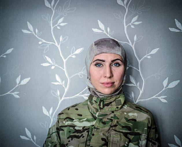 July 2015, Odessa. Amina Okuyeva poses for the photo in a flat she shares with her mother and son. Amina left war-torn Chechnia and moved to Odessa where she studied and become a doctor. She was on Maidan from December 2014 working as a medical volunteer. In that time her husband was in prison accused of the attempt to kill Russian President V. Putin. After Euromaidan revolution he was pardoned and together with Amina joined