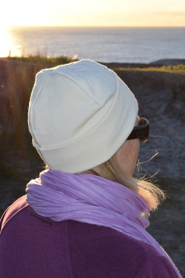 Marcus' wife Kerry on a chilly dawn coastal walk, snug in a Lindner fine wool beanie.