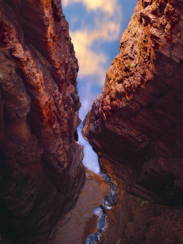 Looking 100 metres down into the gorges of Karijini National Park makes you feel so small. The warm sunrise light on the clouds above is reflected in the water below. I like the way it feels like you are looking up and out of the gorge.  Sony A7r, Sony 70-200mm f/4 @ 129mm, 2s @ f11, ISO 100