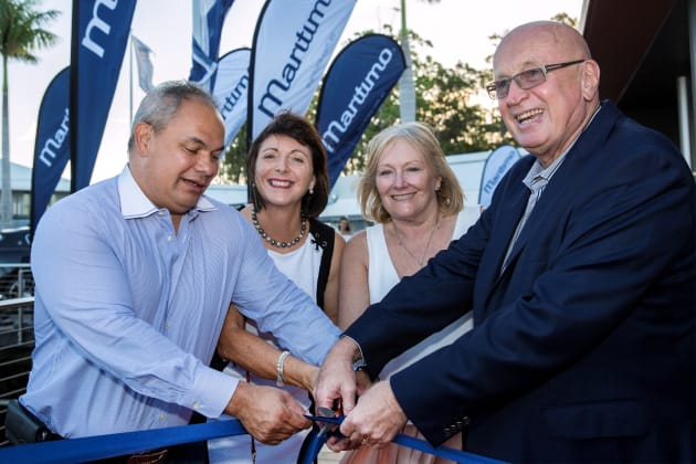 Gold Coast Mayor Councillor Tom Tate and Mayoress Mrs Ruth Tate (left) cutting the ribbon to open the new Maritimo Sanctuary Cove centre with Bill and Lesley Barry-Cotter.