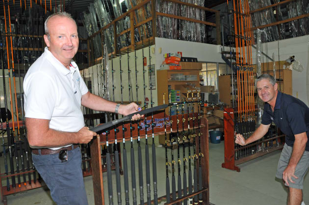 Getting into the spirit: Nautilus Marine Insurance's Damian Pugh (left) tests out the specially-commissioned rods built by Brisbane angling craftsman, Gary Howard.