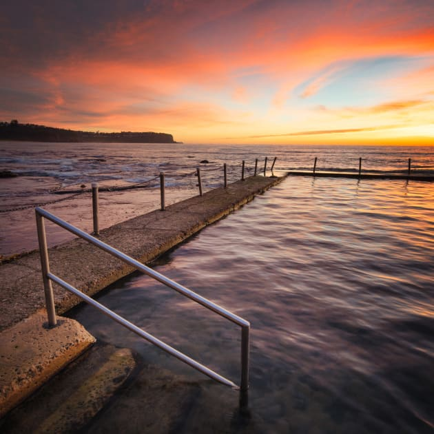 Newport Pool, Northern Beaches, Sydney, NSW. There's not many things more gratifying to a seascaper than when the sky erupts into vivid red and pink colours on a sunrise. This happened to me on this morning at Newport pool. I decided to use the pool railing to help frame the scene and used a shorter shutter speed to keep some texture in the water. This also helped me later capture images of the swimmers as they moved across the pool. Sony A7R, Canon 17mm TS-E f/4L, 1/10 sec @ f/11, ISO 100, tripod.