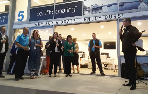 Phillip Pitt, Pacific Boating managing director (right), welcomes staff and members to the company's 10th birthday celebration.