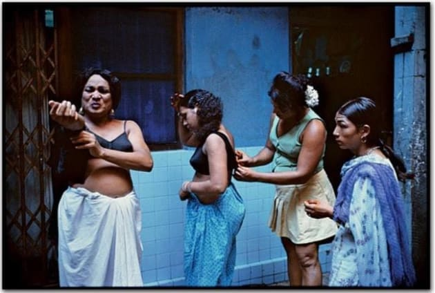 Mary Ellen Mark's original image. In order to capture this, Mark spent three months befriending the prostitutes who worked on Falkland Road, in Bombay, for her 1978 series.