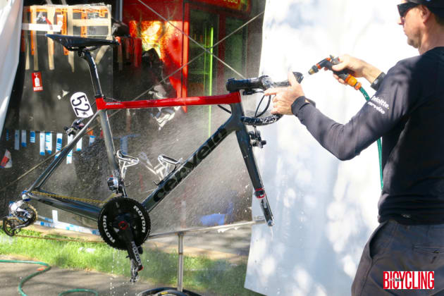 A team mechanic rinses off this Cervelo at the tour village after a day's racing. Image: Nat Bromhead