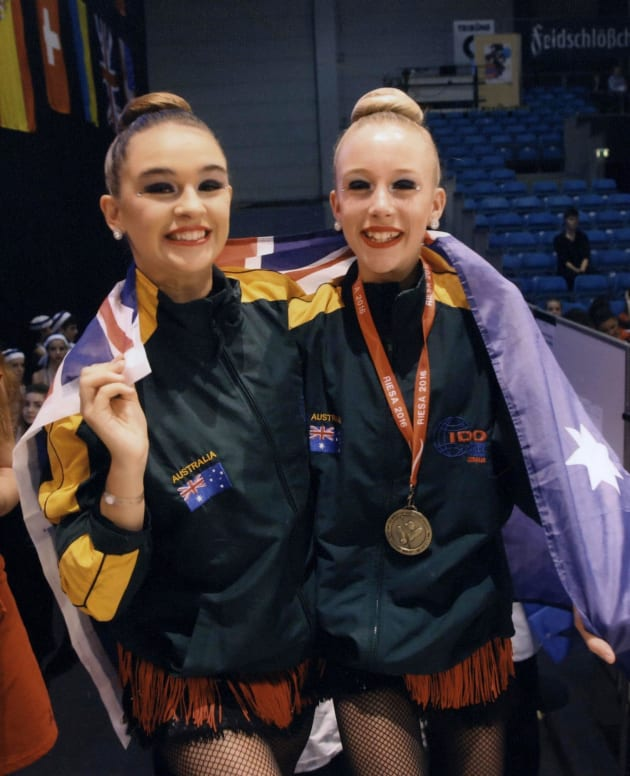Tayla Minchinton (right) with friend Kyla Borghero at the 2016 IDO World Dance Cup in Korea.