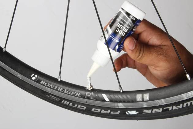 Using an applicator bottle or syringe, inject the sealant through the valve stem. Check with the sealant manufacturer for the recommended amount but 30ml should suffice for most 25c road tyres.