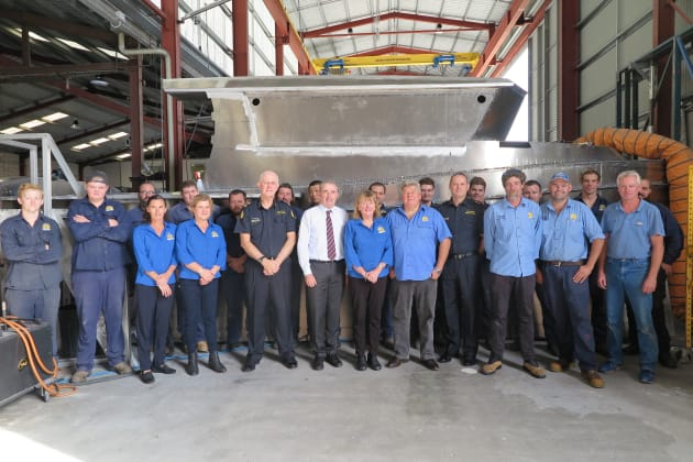Staff at Yamba Welding & Engineering with Australian Border Force officals and the Federal member for Page, Kevin Hogan (in white shirt). Photo: Zenia Anderson, Australian Border Force.