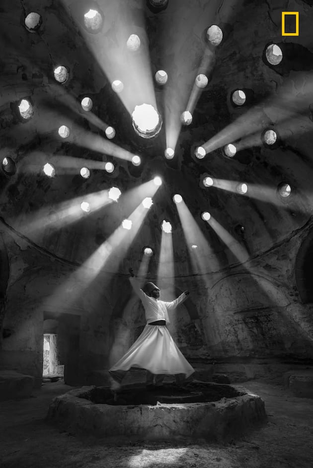 Photo and caption by F. Dilek Uyar/National Geographic Travel Photographer of the Year. 1st Place, People: worship. This photo was taken in Konya. Willing Dervish in an historical place of Sille Konya Turkey. The 'dance' of the Whirling Dervishes is called Sema and is a symbol of the Mevlevi culture. According to Mevlana's teachings, human beings are born twice, once of their mothers and the second time of their own bodies.