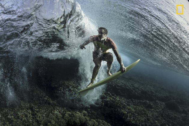 Photo and caption by Rodney Bursiel/National Geographic Travel Photographer of the Year. 3rd Place, People: Under The Wave. I recently traveled to Tavarua, Fiji to do some surf photography with pro surfer Donavon Frankenreiter at Cloudbreak. I'm always looking for new angles and perspectives. The usual surf shots have all been done so we decided to get a little creative. Makes you look twice.