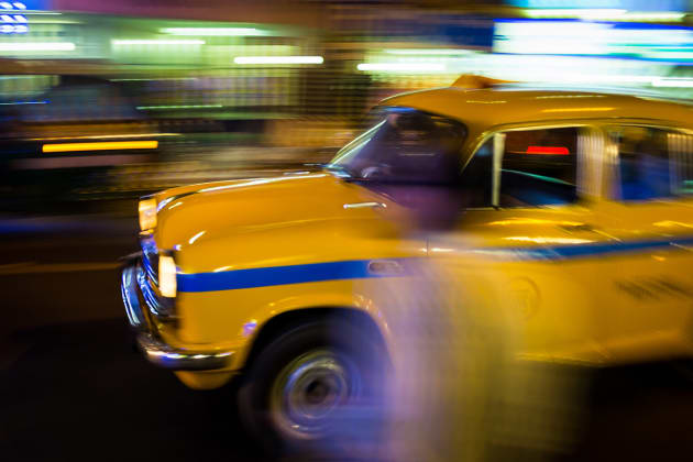 The iconic yellow cabs of Kolkata can be found on almost every street. Due to the number of taxis on the roads I was able to experiment with some long exposure panning techniques. Fujifilm X100S, 23mm lens @ 23mm, 1/15s @ f11, ISO 200, handheld. Contrast, curves and levels adjustment, sharpening in Photoshop CC. Photo © Drew Hopper.
