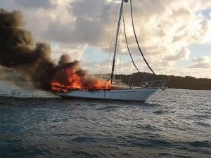 Couple and their 'sea dog' Jack Russell make a lucky escape from yacht inferno in Queensland