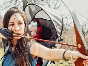 Mother Slammed for Hunting With Baby On Her Back