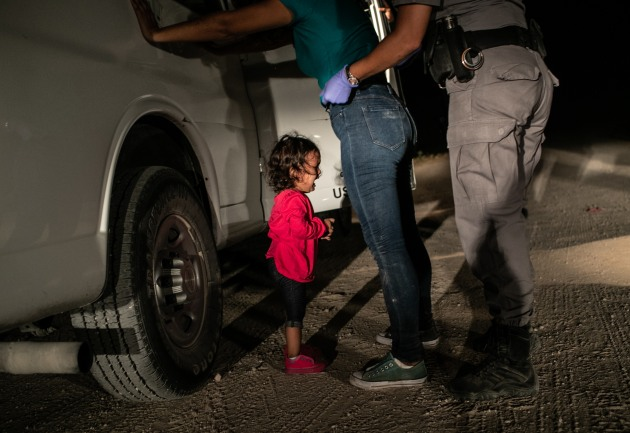 © John Moore. Winner - World Press Photo of the Year. A two-year-old Honduran asylum seeker cries as her mother is searched and detained near the U.S.-Mexico border on June 12, 2018 in McAllen, Texas. They had rafted across the Rio Grande from Mexico and were detained by U.S. Border Patrol agents before being sent to a processing center. The following week the Trump administration, under pressure from the public and lawmakers, ended its contraversial policy of separating immigrant children from their parents at the U.S.-Mexico border. Although the child and her mother remained together, they were sent to a series of detention facilities before being released weeks later, pending a future asylum hearing.