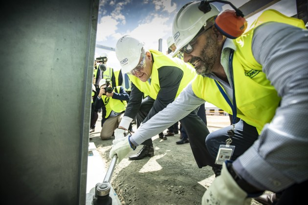 PM Scott Morrison tightening a bolt for the Assembly Hall. Civmec